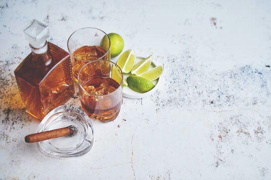 Whiskey sour drink with lemon in glass on stone rustical background