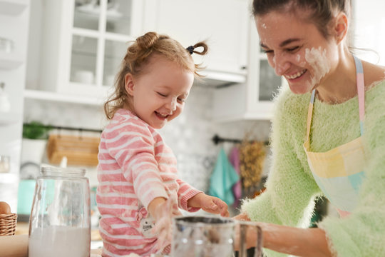 Mum and her little daughter enjoying in the kitchen