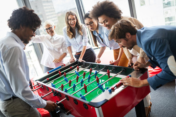 Multiracial people having fun in office room, excited diverse employees enjoying activity at work