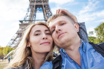 Couple man and woman together in the journey of self against the backdrop of the Eiffel tower