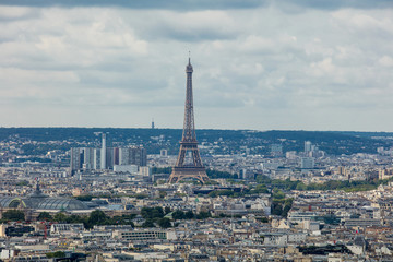 Landscape of Paris with a beautiful view from the top of the city blocks and, standing out against the roofs, the Eiffel tower