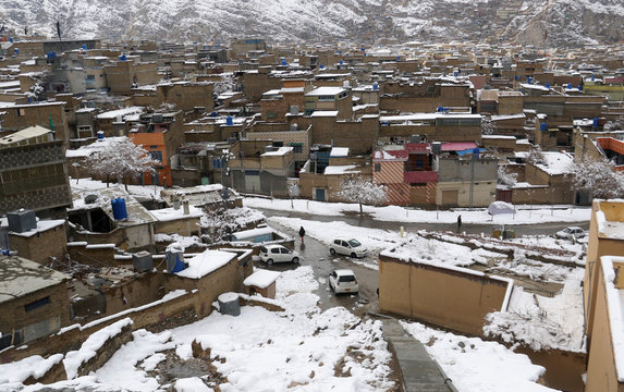 A general view of residential area after a snowfall in Mariabad, Quetta