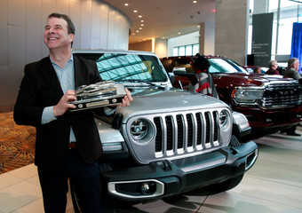 Jim Morrison, Head of Jeep Brand FCA North America, holds the trophy after winning the 2020 North American Truck of the Year for the 2020 Jeep Gladiator in Detroit