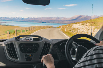 Photo of a person driving a campervan in New Zealand