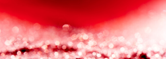 Red blurred abstract shiny valentines day background with bokeh effect, festive pink glitter sparkles