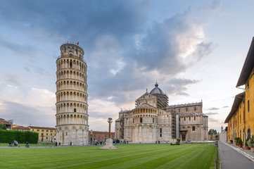Evening light an Pisa center, view of most famous attractions, Duomo cathedral and tilting tower. Pisa, Italy,