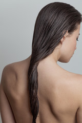 Portrait of woman with wet hair rear view  focus on hair