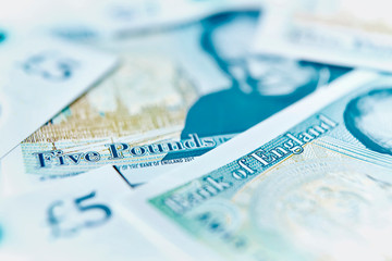 Close up five pound notes