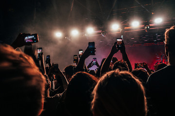 Crowd with smart phones filming music concert