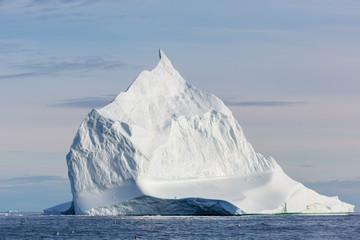 Majestic white iceberg on sunny ocean Greenland