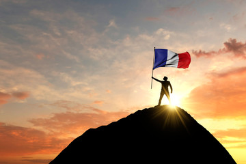 French flag being waved at the top of a mountain summit. 3D Rendering Fotomurales
