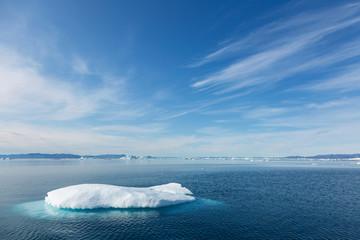 Melting polar ice on sunny blue Atlantic Ocean Greenland Fotoväggar