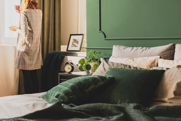 Dark green trendy interior design in fashionable apartment, copy space on empty wall Wall mural