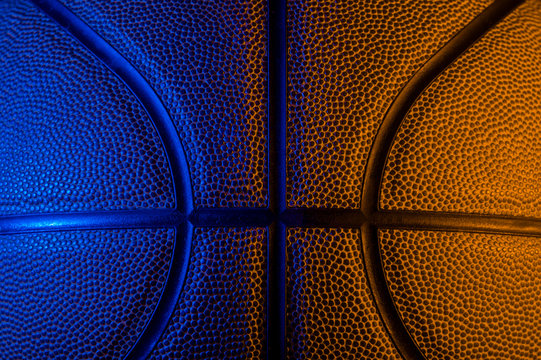 Closeup detail of basketball ball texture background. Blue neon Banner Art concept