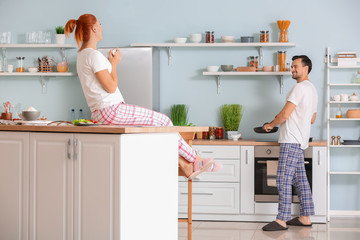 Happy couple in kitchen at home