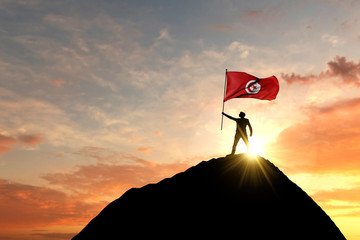 Photo sur Aluminium Abstract wave Tunisia flag being waved at the top of a mountain summit. 3D Rendering