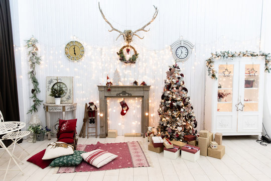 Christmas tree with gifts and fireplace