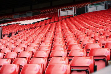 Bright red stadium seat in Liverpool. Wall mural