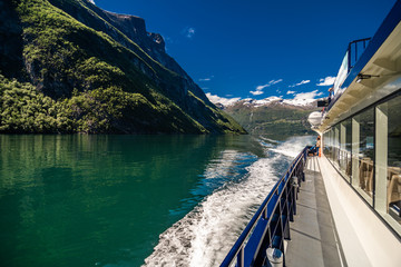 Geiranger, Norway - June, 2019: Ferry sailing on the Geirangerfjord, one of the most popular destination in Norway and UNESCO World Heritage Site. Geiranger