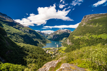 Picturesque summer scene of Geiranger port, western Norway. Colorful view of Sunnylvsfjorden fjord.