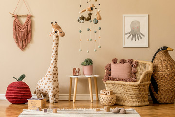 Stylish scandinavian interior of child room with mock up frame, natural toys, hanging decoration,...