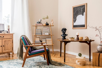 Interior design of stylish library room with retro armchair, wooden table, bookstand, books, mock...