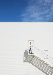 Scientist standing on platform against building