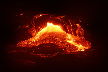 "Detailed view of an active lava flow, hot magma emerges from a crack in the earth, the glowing lava appears in strong yellows and reds - Location: Hawaii, Big Island, volcano ""Kilauea"""