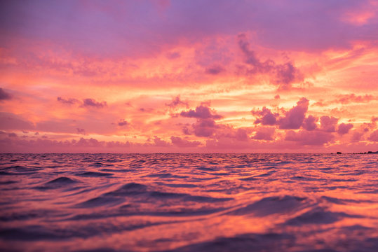 Tropical pink and purple sunset over ocean