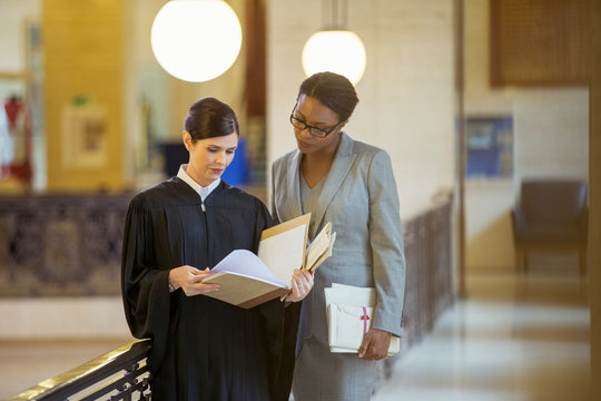 Judge and lawyer looking through documents