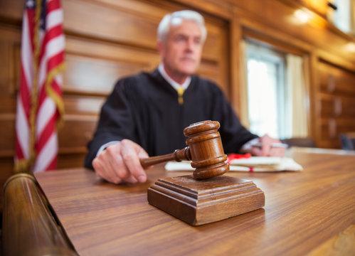 Judge holding gavel in court