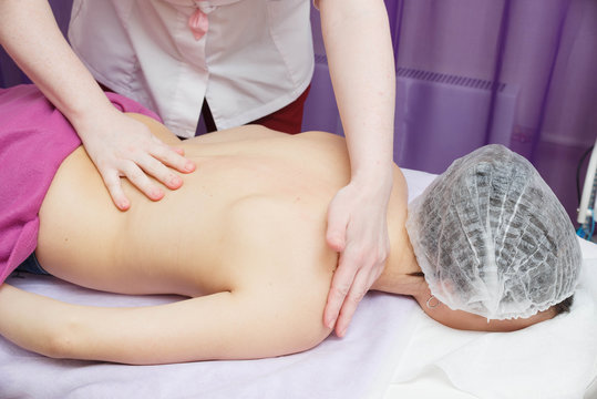 Massage on the problem areas of the body for weight loss and body correction.