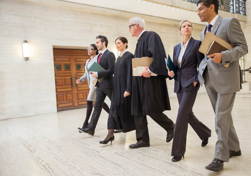 Judges and lawyers walking through courthouse together
