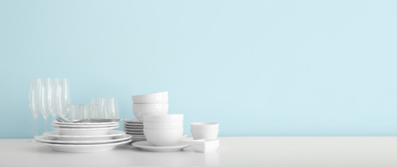 Set of clean dishware on table with space for text