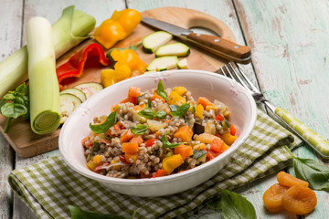 mixed spelt salad with mixed vegetables and dried apricot