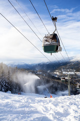 Wall Mural - Whistler, British Columbia, Canada. Gondola going up the mountain during a vibrant and sunny winter day.
