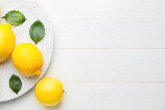 Fresh ripe lemons on white table