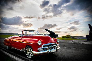 Cuban car on the road at sunset