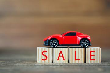 wooden cubes, car on cubes, inscription discount or rent, sale concept