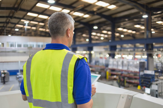 Supervisor with clipboard in steel factory