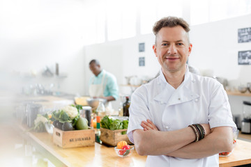 Portrait smiling chef in commercial kitchen