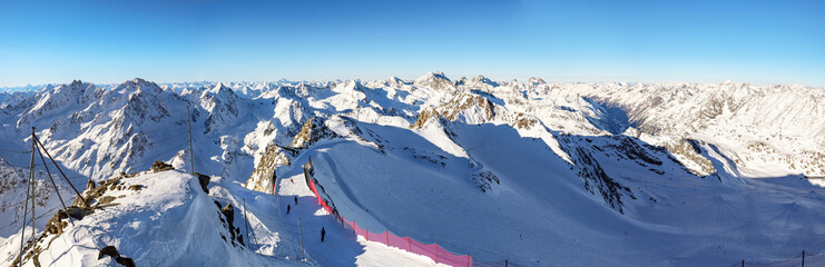 View from Pitztal glacier into the high alpine mountain landscape with cable car station and ski slope in winter with lots of snow and ice, Austrian Alps in Tirol Austria