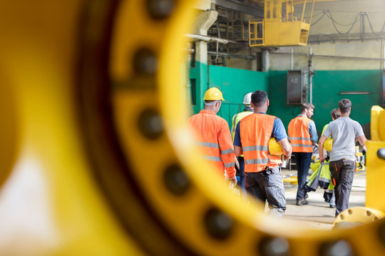 Steel workers walking in factory