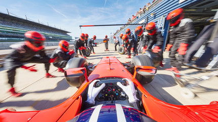 Pit crew ready for formula one race car in pit stop