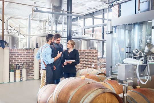 Brewers meeting, talking at wooden casks