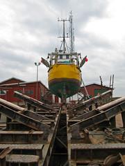 Laesoe / Denmark: Traditional fishing cutter in a small dockyard in Oesterby Havn