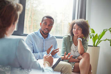 Couple talking to therapist in couples therapy session