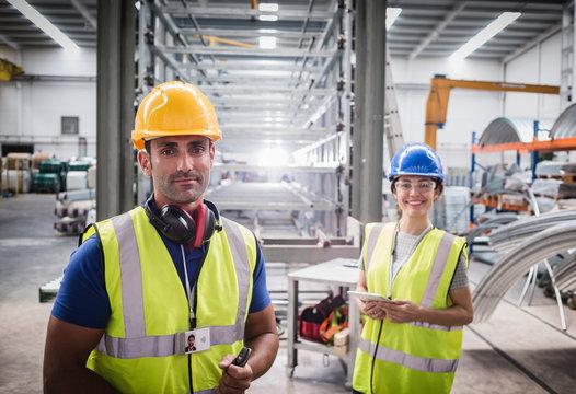 Portrait confident workers in steel factory