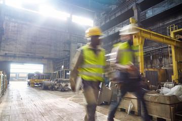 Steelworkers walking in steel mill