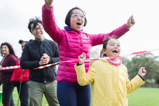 Enthusiastic family spectators cheering at charity run